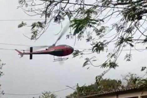 Bandidos sequestram helicóptero para resgatar comparsa e piloto impede... Cenas impressionantes! (veja o vídeo)